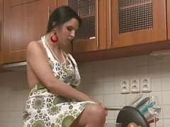 Rotund girl in the kitchen embarked wanking