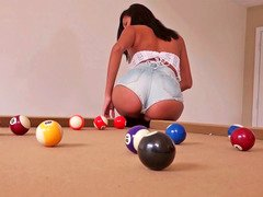 Attractive girl is having a extremely sexy game of pool