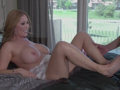 Hot mom is rubbing dick with feet