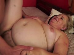 A plump and furthermore nasty granny is riding a man on the bed and furthermore she is moaning
