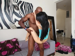 Russian broad is pulling on a large black cock and has interracial sex