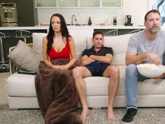 A hot floozy is getting her pussy fucked behind her husband's back