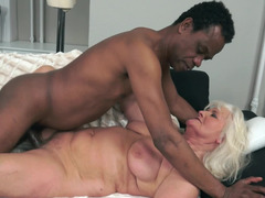 A granny that loves black purple rod is having interracial sex here