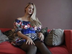 At home in first-class stockings and high heels