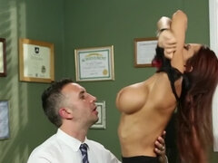 Redhead secretary bends over boss's desk to receive his pecker