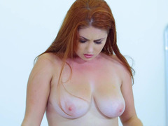 Redhead that has natural boobs is getting cum over her boobs