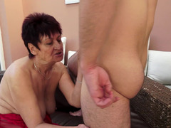 Brown haired granny with sizeable natural boobies gets a sizeable meat pole