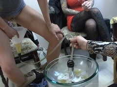 Femdom porn scene with three mistresses forcing a human toilet to drink their pee