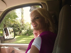 A blonde with large bouncy bra buddies is fucked in the car and licked too