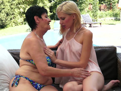 Lustful dark haired granny fools around with a pretty blonde 18-19 year old