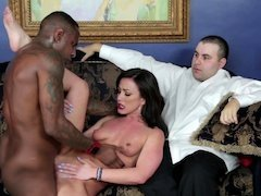 A hot brunette is getting fucked in front of her husband by a black dude