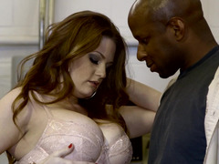 A black dude is pushing his meaty pole into a hot redhead