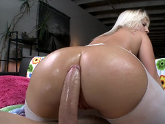 A gross toy is plugging a large ass. The blonde loves that