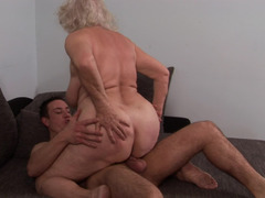 A granny that loves young-looking dudes is getting her unshaved overweight cum bucket pounded