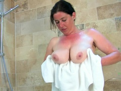 Janey bathes her big tits and big muff