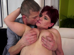 A good granny that has short hair is getting her soggy fuck hole caressed