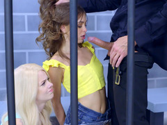 Two bitches in their prison cell are getting fucked by a horny cop