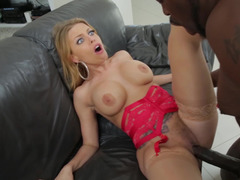 Busty blonde receives a big cock in her wet pussy on the sofa