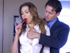 A brunette is getting a large shaft in her cunt in the office