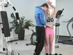 Sportive slender body of blonde honey attracts coach's attention