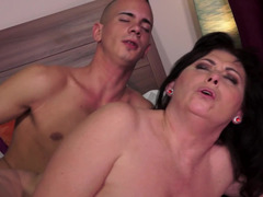 A hot granny is placing her mouth on a young and hard cock