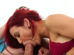 Horny, red haired woman is sucking cock