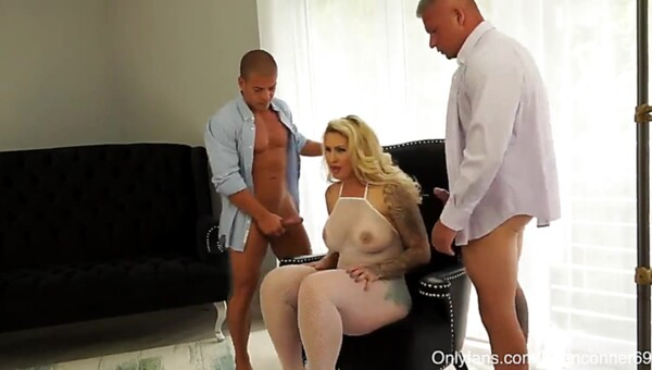 Pornstar is double penetrated by two athletic men