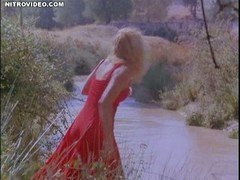 Undressed celeb Ellen Barkin in Siesta unclothing by the river