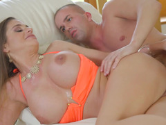 Breasty lady has a talent that helps her to please her fella