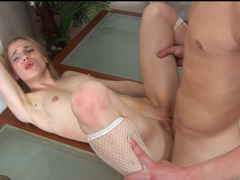 A blonde with a shaved pussy is getting laid by two large lads