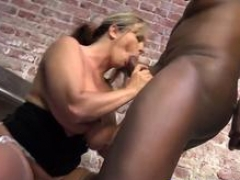 Busty MILF Amber Lynn Bach fucks with a big black cocked stud in a prison cell