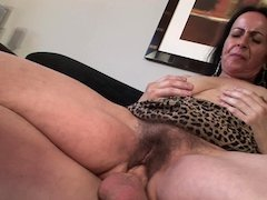 A nasty old granny is getting her hairy pussy filled up by dick