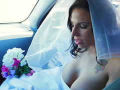 A woman gets penetrated in her wedding gown on the bed