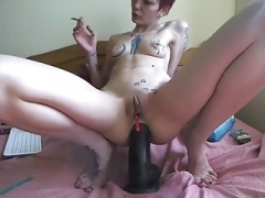 camgirl play with a sizeable dong