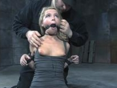 Ligatured submissive toyed during BDSM
