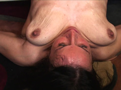 A granny with saggy tits is getting penetrated deeply in this video