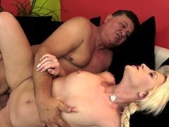 A grandpa with a big cock penetrates a blonde slut with small nipples