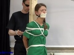 Nurse pegged down and tape gagged